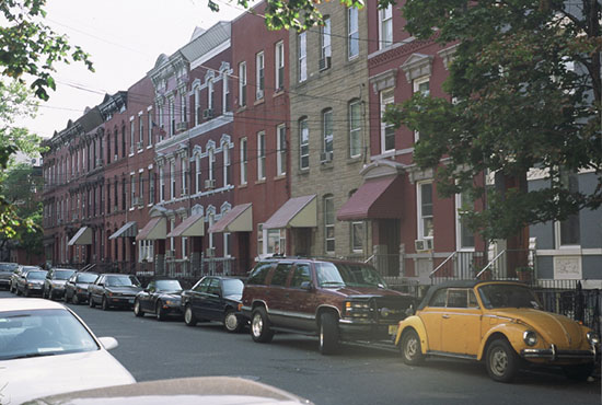 Residential street in uptown Hoboken with turn-of-the-century row homes.