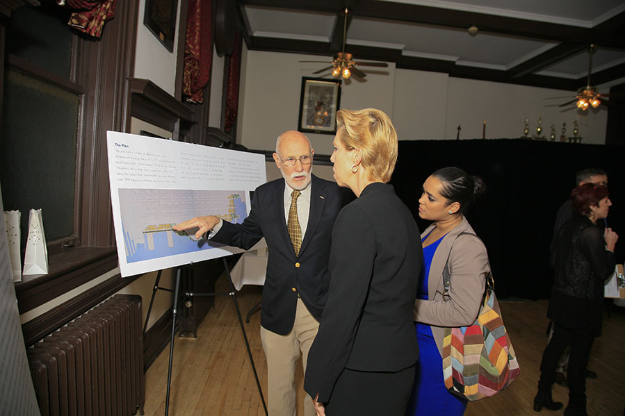 FBW president Jim Vance showing the plan to Ann Logan and another representative from Care Point Health.