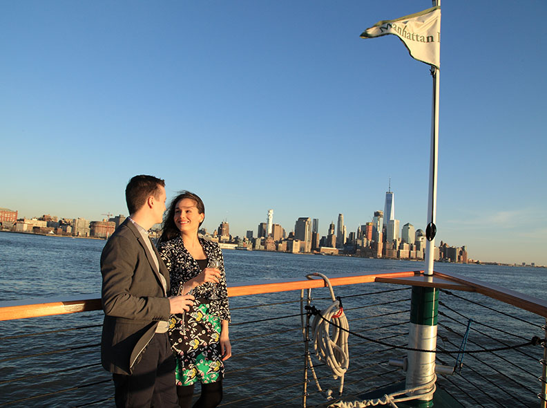 Mike Polumbo and Andrea Morales on the bow. with view of lower Manhattan.