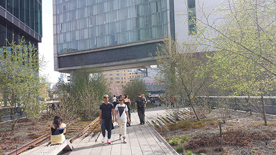 The High Line, which is routed through the middle of blocks, rather than above the City's streets, here passes under a residential building.